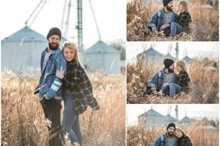 Urban couple standing and sitting in a field in front of a silo in Tipp City, Ohio.