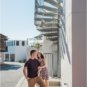 Couple standing on spiral staircase steps in Rosemary Beach, Florida.